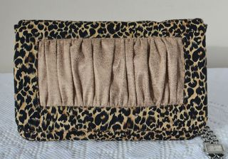 The Eve Cl;utch in an animal print!