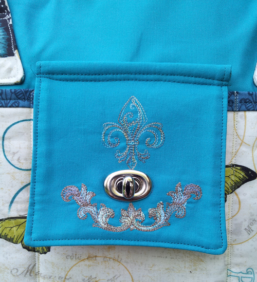 The gorgeous embroidered flap on Rachel's Stow It All Tote