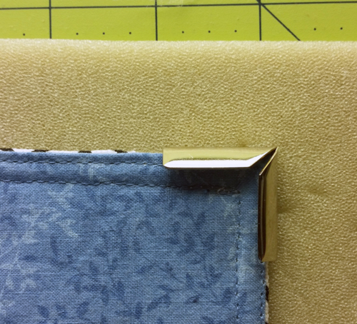 Corner placement on top of headliner foam--fabric side down