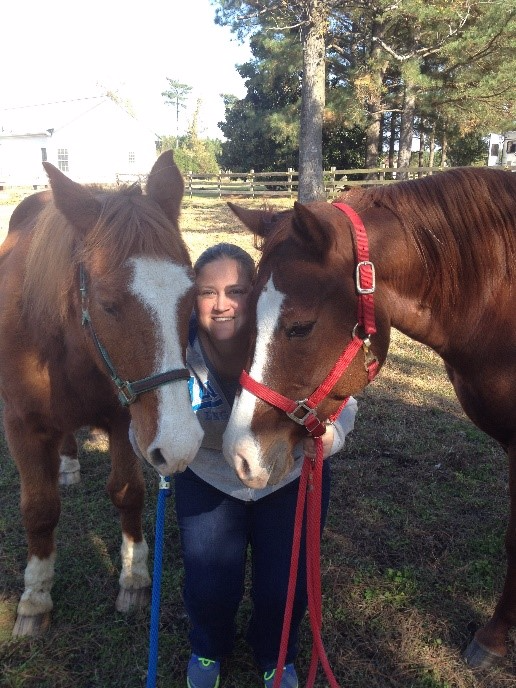 Amanda with her horses.